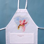 "This kids apron (17''wide, 23"" long) with front pocket is the perfect size for mom's little helper. Ham-let is the lucky piglet to adorn the apron. Spun polyester, machine wash."